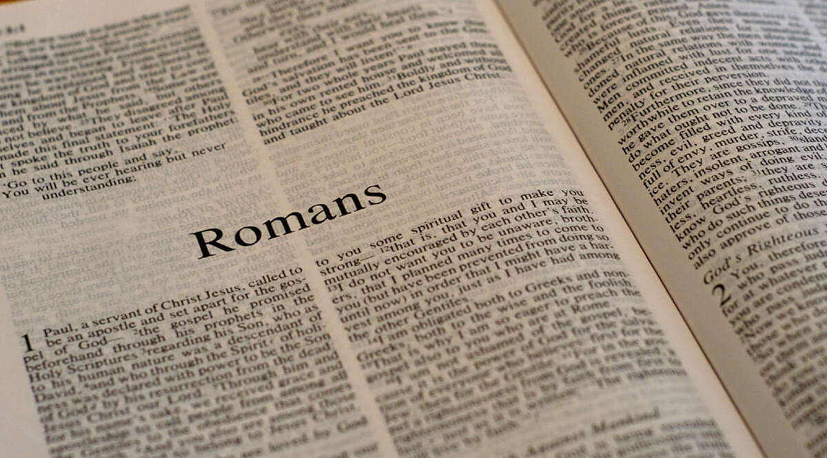Bible Open to Romans 1